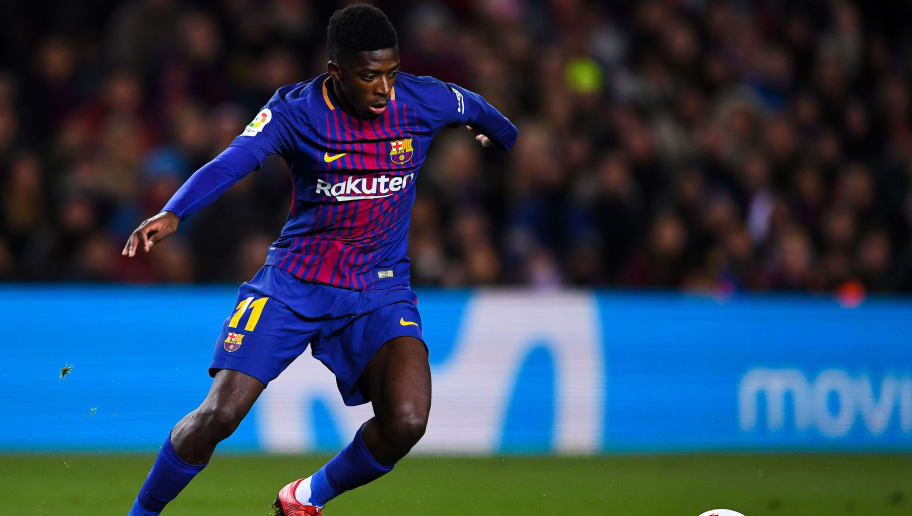 BARCELONA, SPAIN - JANUARY 11:  Oussame Dembele of FC Barcelona runs with the ball during the Copa del Rey round of 16 second leg match between FC Barcelona and Celta de Vigo at Camp Nou on January 11, 2018 in Barcelona, Spain.  (Photo by David Ramos/Getty Images)