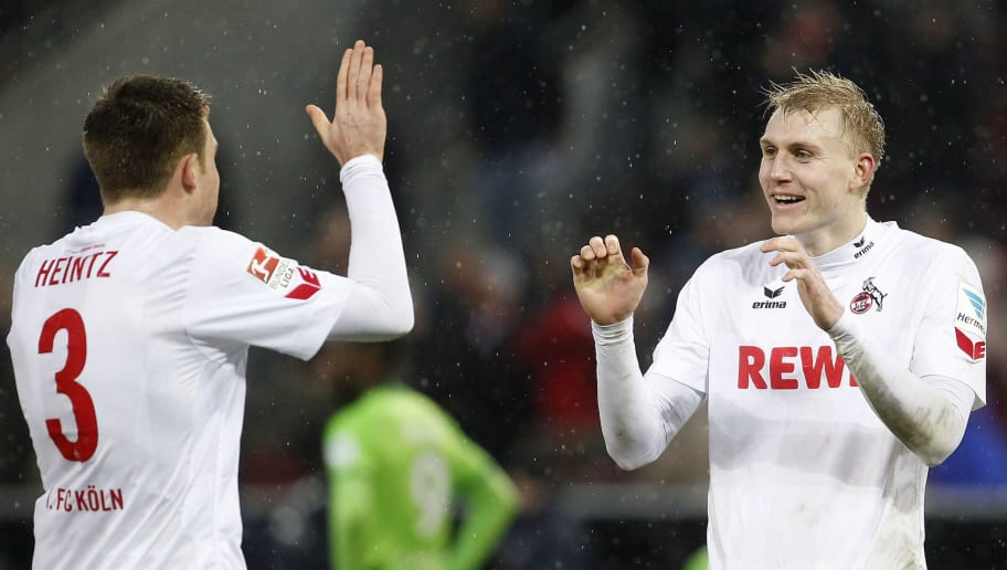 COLOGNE, GERMANY - FEBRUARY 04:  Dominique Heintz of Cologne (L) and Frederik Soerensen of Cologne celebrate the victory 1:0 during the Bundesliga match between 1. FC Koeln and VfL Wolfsburg at RheinEnergieStadion on February 4, 2017 in Cologne, Germany. (Photo by Mika Volkmann/Bongarts/Getty Images)