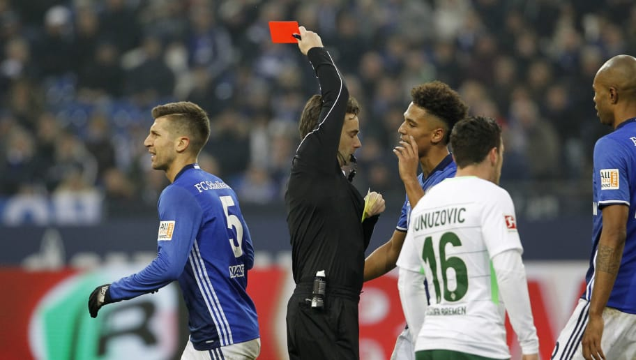 GELSENKIRCHEN, GERMANY - FEBRUARY 03:  Referee Guido Winkmann (M) shows Matija Nastasic of Schalke (L) the yellow-red card during the Bundesliga match between FC Schalke 04 and SV Werder Bremen at Veltins-Arena on February 3, 2018 in Gelsenkirchen, Germany. (Photo by Mika Volkmann/Bongarts/Getty Images)