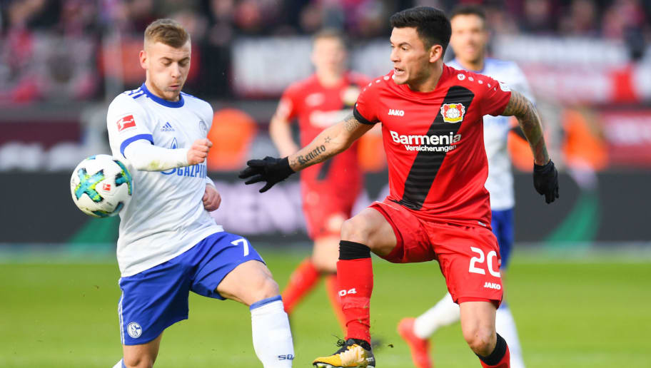 Schalke's German midfielder Max Meyer (L) and Leverkusen's Chilean midfielder Charles Mariano Aránguiz vie for the ball during the German first division Bundesliga football match Bayer Leverkusen vs Schalke 04 in Leverkusen, western Germany, on February 25, 2018. / AFP PHOTO / Patrik STOLLARZ / RESTRICTIONS: DURING MATCH TIME: DFL RULES TO LIMIT THE ONLINE USAGE TO 15 PICTURES PER MATCH AND FORBID IMAGE SEQUENCES TO SIMULATE VIDEO. == RESTRICTED TO EDITORIAL USE == FOR FURTHER QUERIES PLEASE CONTACT DFL DIRECTLY AT + 49 69 650050         (Photo credit should read PATRIK STOLLARZ/AFP/Getty Images)