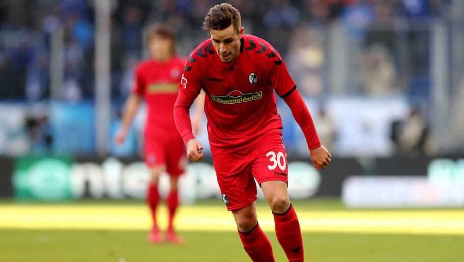SINSHEIM, GERMANY - FEBRUARY 24: Christian Guenter of Freiburg runs with the ball during the Bundesliga match between TSG 1899 Hoffenheim and Sport-Club Freiburg at Wirsol Rhein-Neckar-Arena on February 24, 2018 in Sinsheim, Germany. The match between Hoffenheim and Freiburg ended 1-1. (Photo by Christof Koepsel/Bongarts/Getty Images)