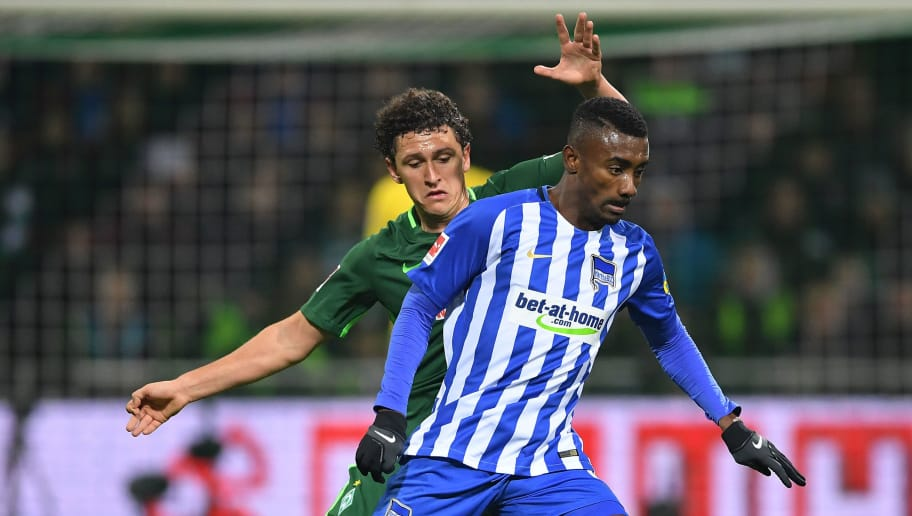 BREMEN, GERMANY - JANUARY 27: Milos Veljkovic of Bremen (behind) fights for the ball with Salomon Kalou of Berlin during the Bundesliga match between SV Werder Bremen and Hertha BSC at Weserstadion on January 27, 2018 in Bremen, Germany. (Photo by Stuart Franklin/Bongarts/Getty Images)