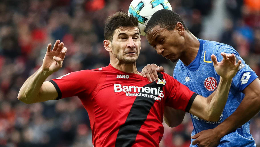 LEVERKUSEN, GERMANY - JANUARY 28: Lucas Alario #13 of Bayer Leverkusen and Abdou Diallo #4 of FSV Mainz 05 (R) battle for the ball during the Bundesliga match between Bayer 04 Leverkusen and 1. FSV Mainz 05 at BayArena on January 28, 2018 in Leverkusen, Germany. (Photo by Maja Hitij/Bongarts/Getty Images)