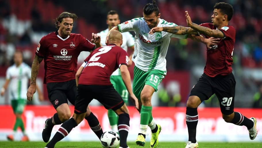 NUREMBERG, GERMANY - SEPTEMBER 20:  Dave Bulthuis (from L) of Nuernberg, Shawn Parker, Serdar Dursun of Fuerth and #n20# tussle for the ball during the Second Bundesliga match between 1. FC Nuernberg and SpVgg Greuther Fuerth at Grundig Stadion on September 20, 2016 in Nuremberg, Germany.  (Photo by Micha Will/Bongarts/Getty Images)