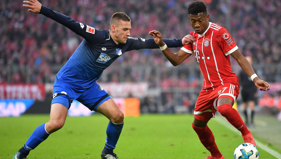 MUNICH, GERMANY - JANUARY 27: Pavel Kaderabek of Hoffenheim (l) fights for the ball with David Alaba of Bayern Muenchen during the Bundesliga match between FC Bayern Muenchen and TSG 1899 Hoffenheim at Allianz Arena on January 27, 2018 in Munich, Germany. (Photo by Sebastian Widmann/Bongarts/Getty Images)