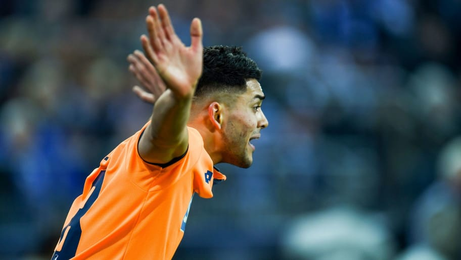 Hoffenheim's German midfielder Nadiem Amiri reacts during the German first division Bundesliga football match FC Schalke 04 vs Hoffenheim, in Gelsenkirchen, western Germany, on February 17, 2018. / AFP PHOTO / Patrik STOLLARZ / RESTRICTIONS: DURING MATCH TIME: DFL RULES TO LIMIT THE ONLINE USAGE TO 15 PICTURES PER MATCH AND FORBID IMAGE SEQUENCES TO SIMULATE VIDEO. == RESTRICTED TO EDITORIAL USE == FOR FURTHER QUERIES PLEASE CONTACT DFL DIRECTLY AT + 49 69 650050         (Photo credit should read PATRIK STOLLARZ/AFP/Getty Images)