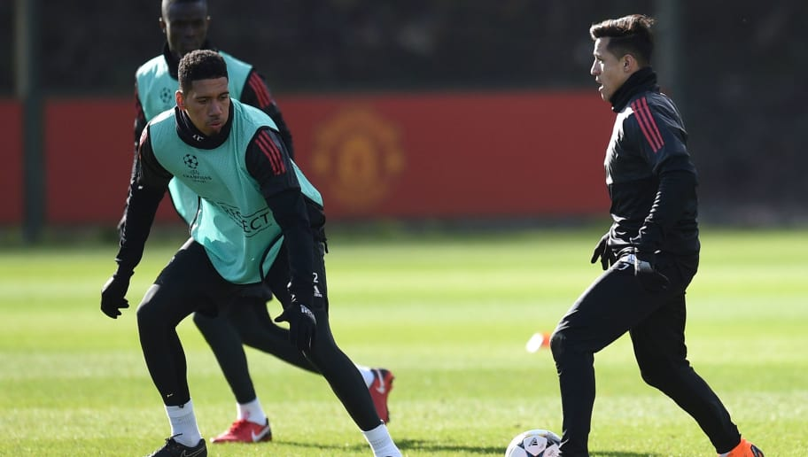 Manchester United's Chilean striker Alexis Sanchez (R) takes on Manchester United's English defender Chris Smalling (L) during a team training session at the club's training complex near Carrington, west of Manchester in north west England on February 20, 2018, on the eve of their UEFA Champions League round of 16 football match against Sevilla. / AFP PHOTO / Oli SCARFF        (Photo credit should read OLI SCARFF/AFP/Getty Images)