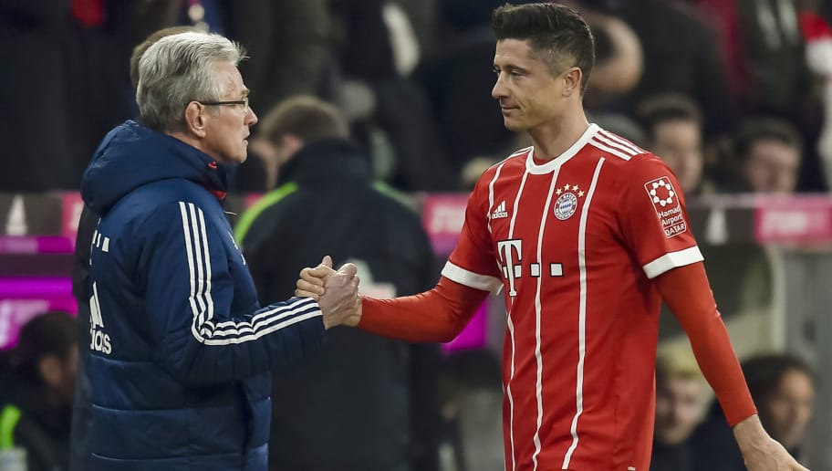 Bayern Munich's German head coach Jupp Heynckes shakes hands with Polish striker Robert Lewandowski as he leaves the pitch during the German first division Bundesliga football match Bayern Munich vs Werder Bremen in Munich, southern Germany, on January 21, 2018. Bayern won 4-2. / AFP PHOTO / Guenter SCHIFFMANN / RESTRICTIONS: DURING MATCH TIME: DFL RULES TO LIMIT THE ONLINE USAGE TO 15 PICTURES PER MATCH AND FORBID IMAGE SEQUENCES TO SIMULATE VIDEO. == RESTRICTED TO EDITORIAL USE == FOR FURTHER QUERIES PLEASE CONTACT DFL DIRECTLY AT + 49 69 650050         (Photo credit should read GUENTER SCHIFFMANN/AFP/Getty Images)