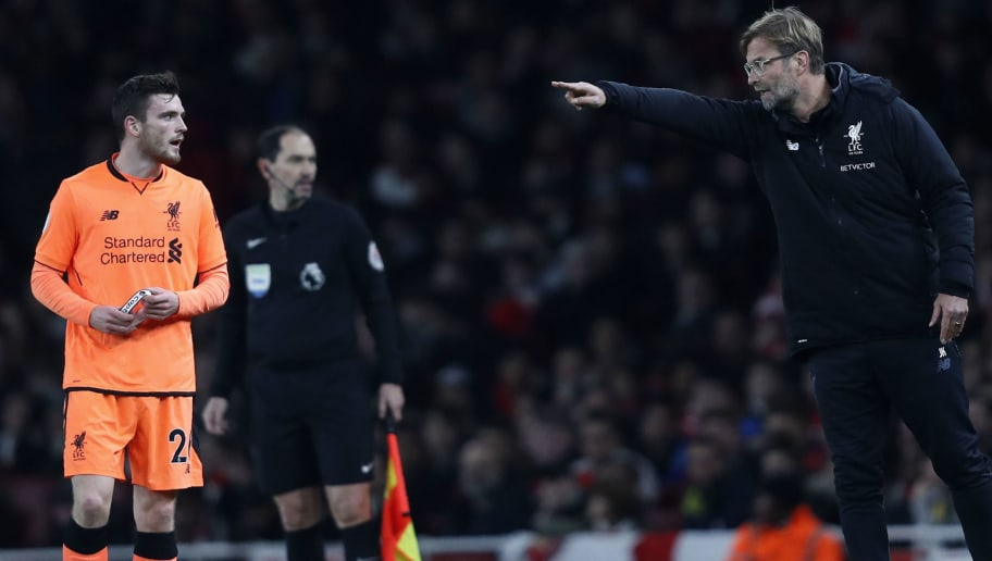 Liverpool's German manager Jurgen Klopp (R) instructs Liverpool's Scottish defender Andrew Robertson during the English Premier League football match between Arsenal and Liverpool at the Emirates Stadium in London on December 22, 2017.  / AFP PHOTO / Adrian DENNIS / RESTRICTED TO EDITORIAL USE. No use with unauthorized audio, video, data, fixture lists, club/league logos or 'live' services. Online in-match use limited to 75 images, no video emulation. No use in betting, games or single club/league/player publications.  /         (Photo credit should read ADRIAN DENNIS/AFP/Getty Images)