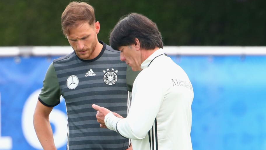 EVIAN-LES-BAINS, FRANCE - JUNE 09:  Joachim Loew, head coach of the German national team talks to his player Benedikt Hoewedes  during a Germany training session ahead of the UEFA EURO 2016 at Ermitage Evian on June 9, 2016 in Evian-les-Bains, France. Germany's opening match at the European Championship is against Ukraine on June 12.  (Photo by Alexander Hassenstein/Getty Images)