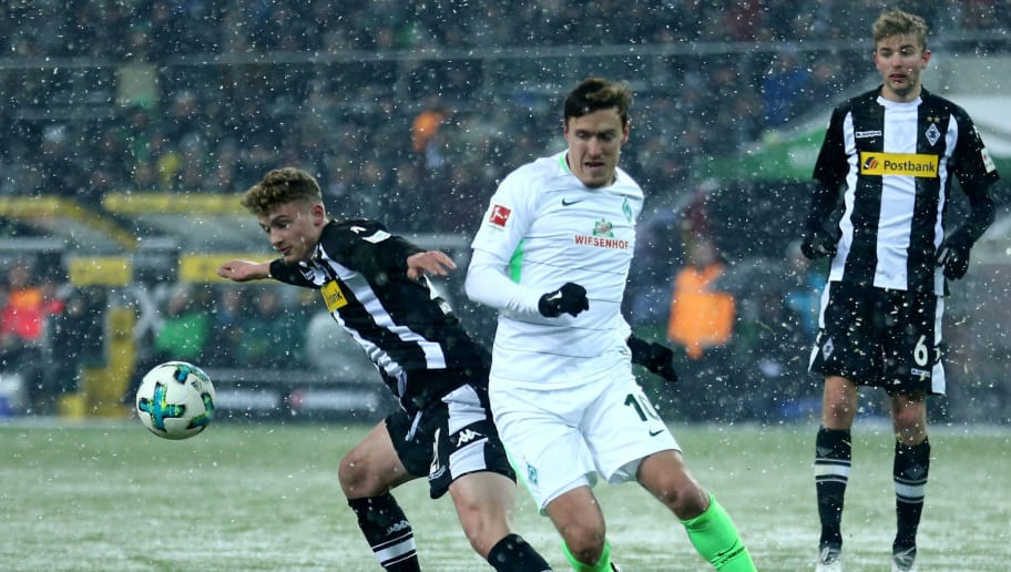 MOENCHENGLADBACH, GERMANY - MARCH 02: (L-R) Mickael Cuisance of Moenchengladbach challenges Max Kruse of Bremen during the Bundesliga match between Borussia Moenchengladbach and SV Werder Bremen at Borussia-Park on March 2, 2018 in Moenchengladbach, Germany. (Photo by Christof Koepsel/Bongarts/Getty Images)