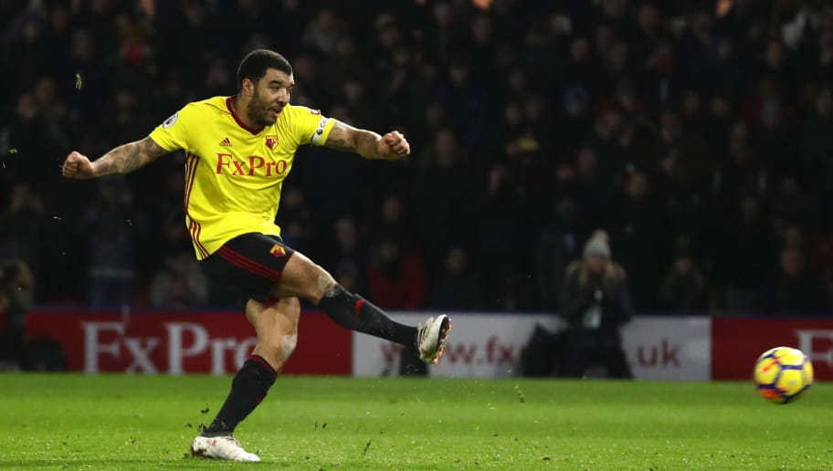 WATFORD, ENGLAND - FEBRUARY 05: Troy Deeney of Watford scores the first goal from the penalty spot during the Premier League match between Watford and Chelsea at Vicarage Road on February 5, 2018 in Watford, England.  (Photo by Catherine Ivill/Getty Images)