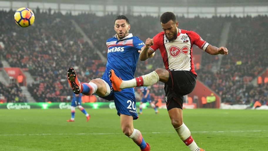 Stoke City's US defender Geoff Cameron (L) vies with Southampton's English defender Ryan Bertrand during the English Premier League football match between Southampton and Stoke City at St Mary's Stadium in Southampton, southern England on March 3, 2018. / AFP PHOTO / Glyn KIRK / RESTRICTED TO EDITORIAL USE. No use with unauthorized audio, video, data, fixture lists, club/league logos or 'live' services. Online in-match use limited to 75 images, no video emulation. No use in betting, games or single club/league/player publications.  /         (Photo credit should read GLYN KIRK/AFP/Getty Images)