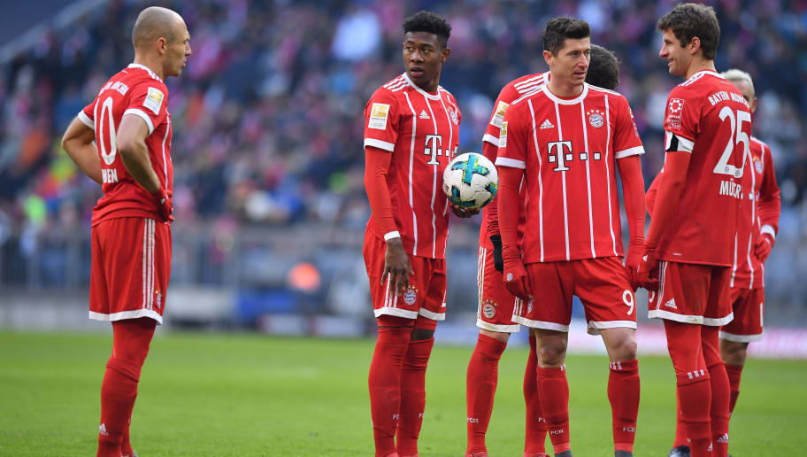 MUNICH, GERMANY - FEBRUARY 24: Arjen Robben (l-r), David Alaba, Robert Lewandowski and Thomas Mueller of Bayern Muenchen stand next to each other before a free kick during the Bundesliga match between FC Bayern Muenchen and Hertha BSC at Allianz Arena on February 24, 2018 in Munich, Germany. (Photo by Sebastian Widmann/Bongarts/Getty Images)