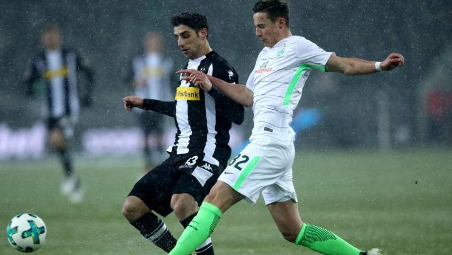 MOENCHENGLADBACH, GERMANY - MARCH 02: Marco Friedl of Bremen (R) challenges Lars Stindl of Moenchengladbach (L) during the Bundesliga match between Borussia Moenchengladbach and SV Werder Bremen at Borussia-Park on March 2, 2018 in Moenchengladbach, Germany. (Photo by Christof Koepsel/Bongarts/Getty Images)