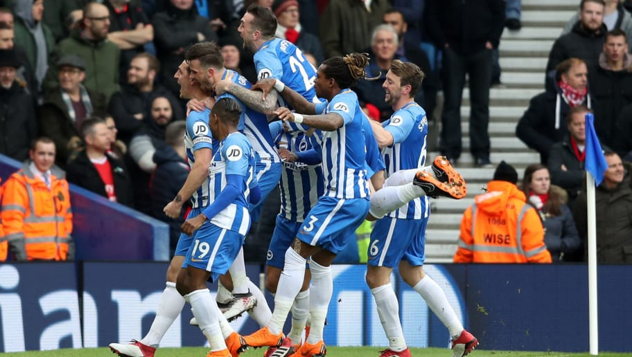 BRIGHTON, ENGLAND - MARCH 04: Lewis Dunk of Brighton and Hove Albion celebrates with team mates after scoring his sides first goal during the Premier League match between Brighton and Hove Albion and Arsenal at Amex Stadium on March 4, 2018 in Brighton, England.  (Photo by Christopher Lee/Getty Images)