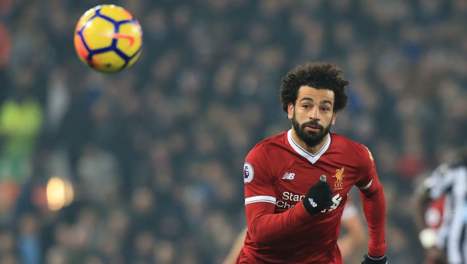 Liverpool's Egyptian midfielder Mohamed Salah chases the ball during the English Premier League football match between Liverpool and Newcastle at Anfield in Liverpool, north west England on March 3, 2018. / AFP PHOTO / Lindsey PARNABY / RESTRICTED TO EDITORIAL USE. No use with unauthorized audio, video, data, fixture lists, club/league logos or 'live' services. Online in-match use limited to 75 images, no video emulation. No use in betting, games or single club/league/player publications.  /         (Photo credit should read LINDSEY PARNABY/AFP/Getty Images)