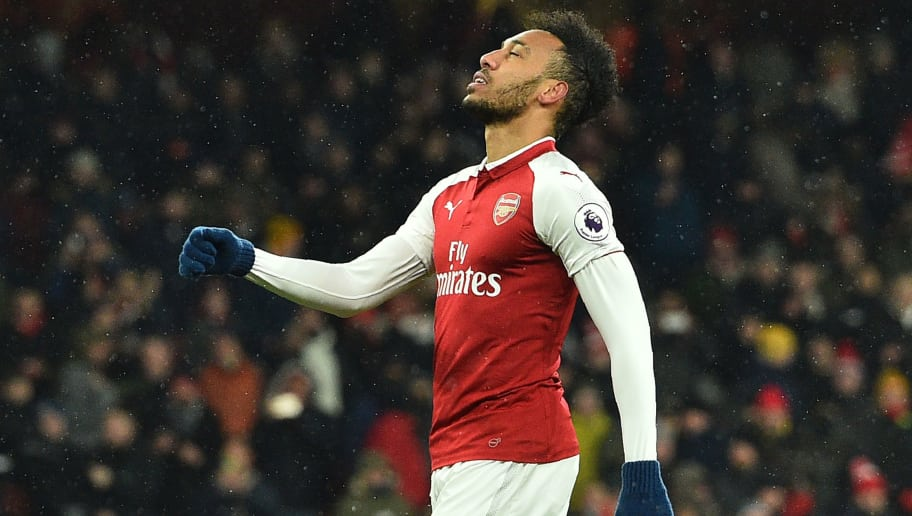 Arsenal's Gabonese striker Pierre-Emerick Aubameyang reacts after having his penalty saved by Manchester City's Brazilian goalkeeper Ederson (not pictured) during the English Premier League football match between Arsenal and Manchester City at the Emirates Stadium in London on March 1, 2018.  / AFP PHOTO / Glyn KIRK / RESTRICTED TO EDITORIAL USE. No use with unauthorized audio, video, data, fixture lists, club/league logos or 'live' services. Online in-match use limited to 75 images, no video emulation. No use in betting, games or single club/league/player publications.  /         (Photo credit should read GLYN KIRK/AFP/Getty Images)