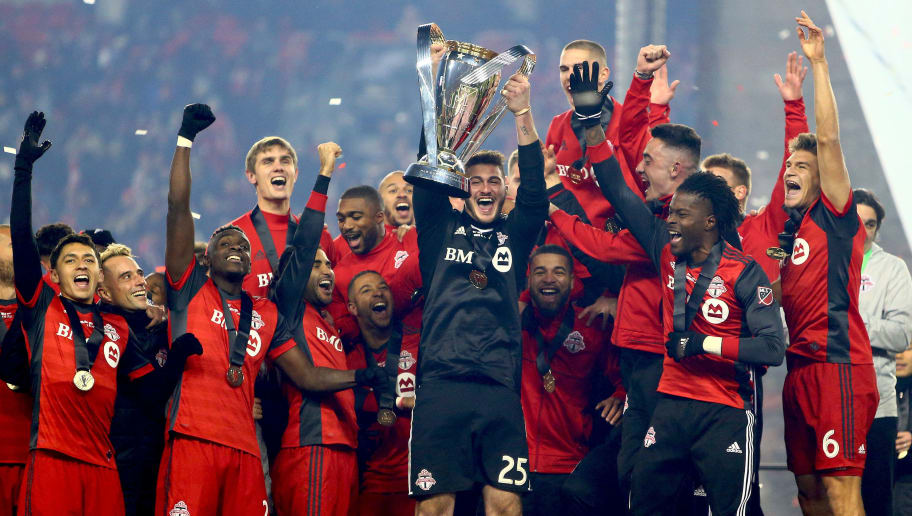 TORONTO, ON - DECEMBER 09:  Alex Bono #25 of Toronto FC lifts the Championship Trophy after winning the 2017 MLS Cup Final against the Seattle Sounders at BMO Field on December 9, 2017 in Toronto, Ontario, Canada.  (Photo by Vaughn Ridley/Getty Images)
