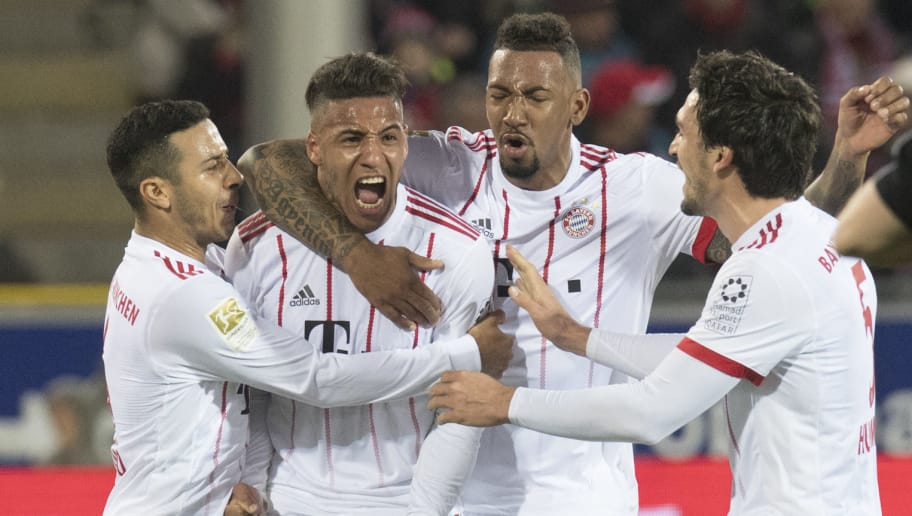 (L-R) Munich's  Spanish midfielder Thiago, French midfielder Corentin Tolisso, defender Jerome Boateng and defender Mats Hummels celebrate after Tolisso scored during the German first division Bundesliga football match SC Freiburg versus Bayern Munich on March 4, 2018 in Freiburg. / AFP PHOTO / THOMAS KIENZLE / RESTRICTIONS: DURING MATCH TIME: DFL RULES TO LIMIT THE ONLINE USAGE TO 15 PICTURES PER MATCH AND FORBID IMAGE SEQUENCES TO SIMULATE VIDEO. == RESTRICTED TO EDITORIAL USE == FOR FURTHER QUERIES PLEASE CONTACT DFL DIRECTLY AT + 49 69 650050         (Photo credit should read THOMAS KIENZLE/AFP/Getty Images)
