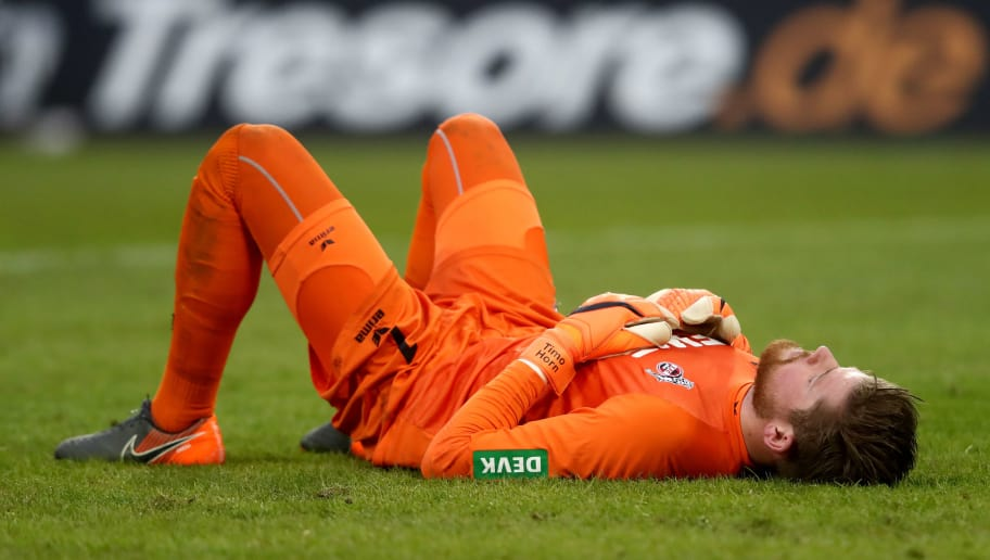 COLOGNE, GERMANY - MARCH 04: Timo Horn of Koeln lies dejected on the pitch after losing 2-3 the Bundesliga match between 1. FC Koeln and VfB Stuttgart at RheinEnergieStadion on March 4, 2018 in Cologne, Germany. (Photo by Christof Koepsel/Bongarts/Getty Images)
