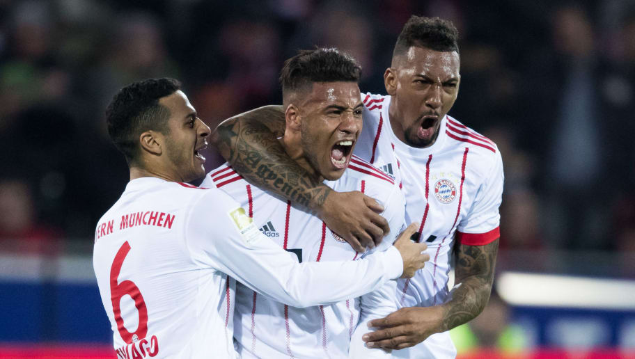 FREIBURG IM BREISGAU, GERMANY - MARCH 04: Corentin Tolisso of Muenchen celebrates his team's second goal with team mates Jerome Boateng (R) and Thiago (L) during the Bundesliga match between Sport-Club Freiburg and FC Bayern Muenchen at Schwarzwald-Stadion on March 4, 2018 in Freiburg im Breisgau, Germany. (Photo by Simon Hofmann/Bongarts/Getty Images)