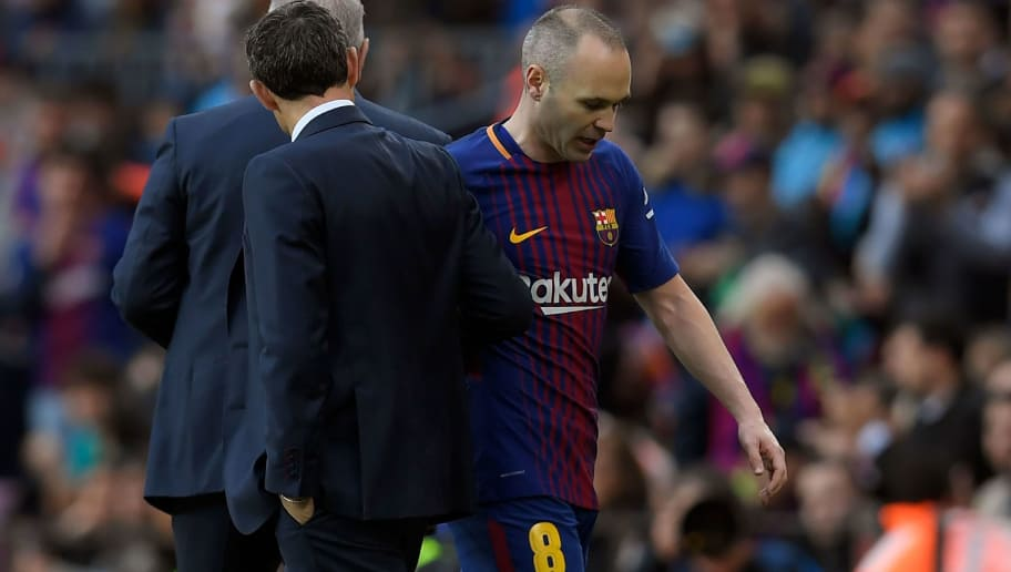 Barcelona's Spanish midfielder Andres Iniesta leaves the pitch during the Spanish league football match FC Barcelona against Club Atletico de Madrid at the Camp Nou stadium in Barcelona on March 04, 2018. / AFP PHOTO / LLUIS GENE        (Photo credit should read LLUIS GENE/AFP/Getty Images)