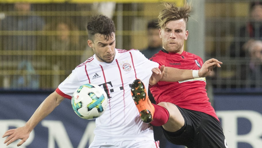 Freiburg's forward Lucas Hoeler (R) and Munich's Spanish defender Juan Bernat vie with the ball during the German first division Bundesliga football match SC Freiburg versus Bayern Munich on March 4, 2018 in Freiburg. / AFP PHOTO / THOMAS KIENZLE / RESTRICTIONS: DURING MATCH TIME: DFL RULES TO LIMIT THE ONLINE USAGE TO 15 PICTURES PER MATCH AND FORBID IMAGE SEQUENCES TO SIMULATE VIDEO. == RESTRICTED TO EDITORIAL USE == FOR FURTHER QUERIES PLEASE CONTACT DFL DIRECTLY AT + 49 69 650050         (Photo credit should read THOMAS KIENZLE/AFP/Getty Images)