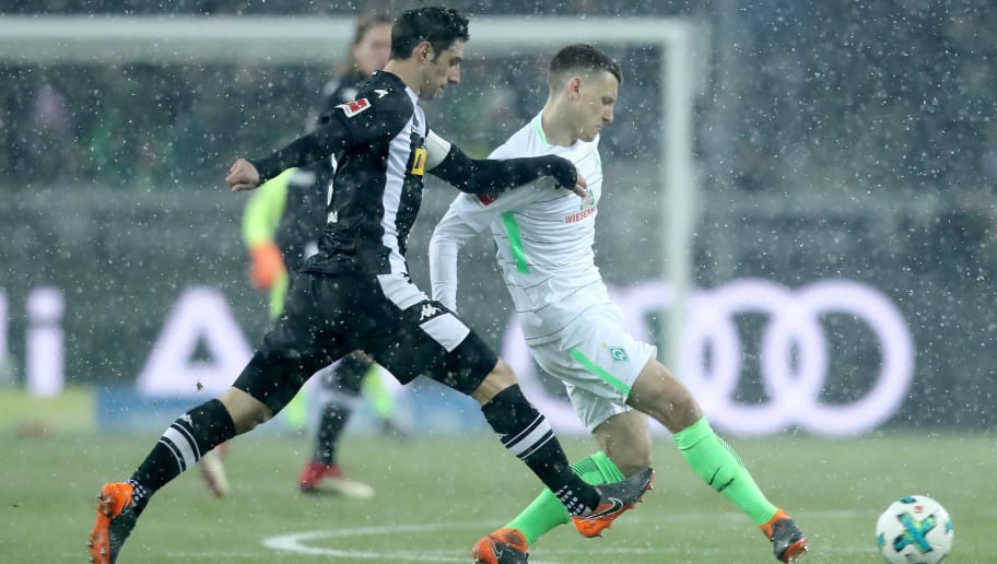 MOENCHENGLADBACH, GERMANY - MARCH 02: (L-R) Lars Stindl of Moenchengladbach challenges Maximilian Eggestein of Bremen during the Bundesliga match between Borussia Moenchengladbach and SV Werder Bremen at Borussia-Park on March 2, 2018 in Moenchengladbach, Germany. (Photo by Christof Koepsel/Bongarts/Getty Images)