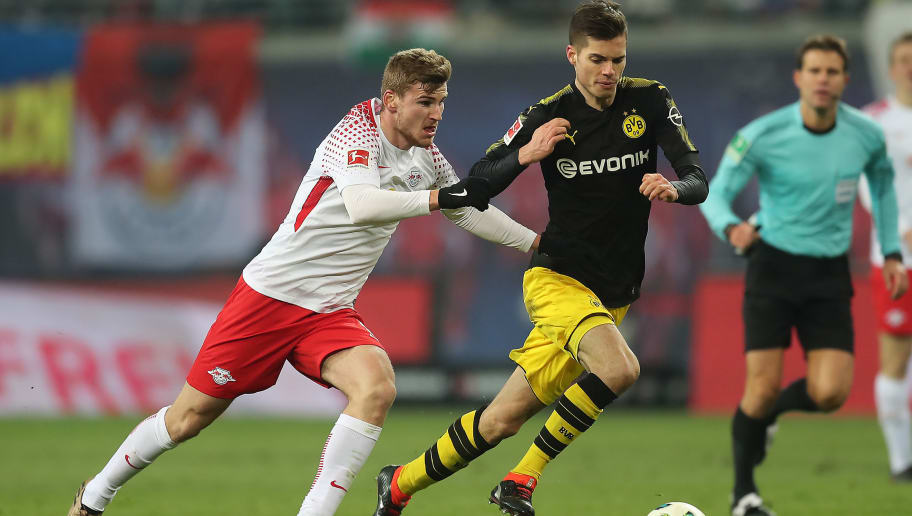 LEIPZIG, GERMANY - MARCH 03: Timo Werner of Leipzig (l) chases Julian Weigl of Dortmund during the Bundesliga match between RB Leipzig and Borussia Dortmund at Red Bull Arena on March 3, 2018 in Leipzig, Germany. (Photo by Boris Streubel/Bongarts/Getty Images)