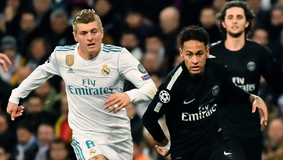 Real Madrid's German midfielder Toni Kroos (L) vies with  Paris Saint-Germain's Brazilian forward Neymar (R) during the UEFA Champions League round of sixteen first leg football match Real Madrid CF against Paris Saint-Germain (PSG) at the Santiago Bernabeu stadium in Madrid on February 14, 2018.   / AFP PHOTO / CHRISTOPHE SIMON        (Photo credit should read CHRISTOPHE SIMON/AFP/Getty Images)