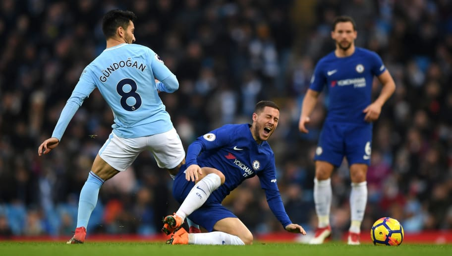 MANCHESTER, ENGLAND - MARCH 04:  Eden Hazard of Chelsea goes down following a tackle from Ilkay Gundogan of Manchester City during the Premier League match between Manchester City and Chelsea at Etihad Stadium on March 4, 2018 in Manchester, England.  (Photo by Shaun Botterill/Getty Images)