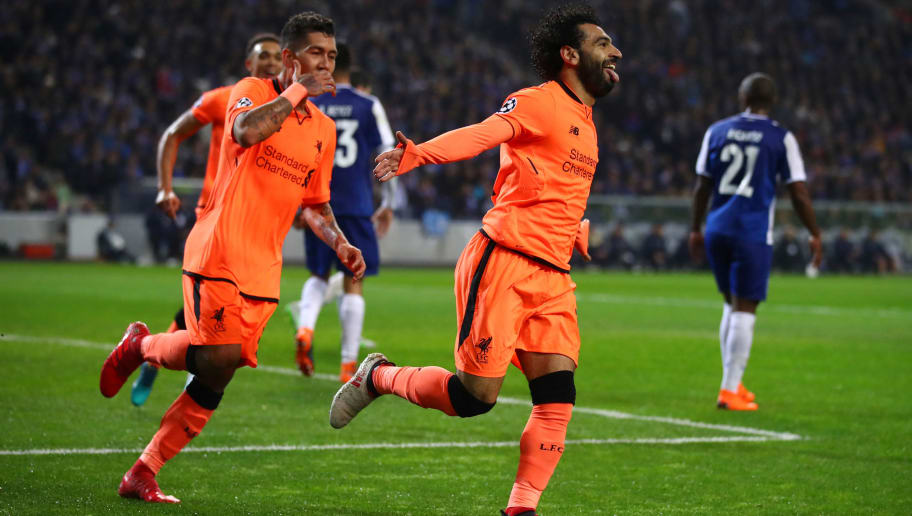 PORTO, PORTUGAL - FEBRUARY 14:  Mohamed Salah of Liverpool celebrates scoring the 2nd goal with Roberto Firmino of Liverpool during the UEFA Champions League Round of 16 First Leg match between FC Porto and Liverpool at Estadio do Dragao on February 14, 2018 in Porto, Portugal.  (Photo by Julian Finney/Getty Images)