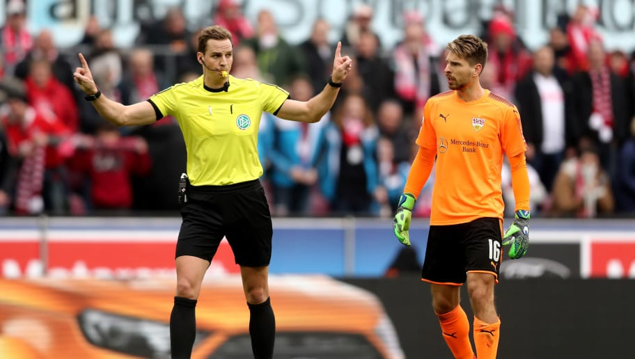 COLOGNE, GERMANY - MARCH 04: (L-R) Referee Soeren Storks decides a video analyst and rejects the goal of Yuya Osako of Koeln (not in the picture) during the Bundesliga match between 1. FC Koeln and VfB Stuttgart at RheinEnergieStadion on March 4, 2018 in Cologne, Germany. (Photo by Christof Koepsel/Bongarts/Getty Images)