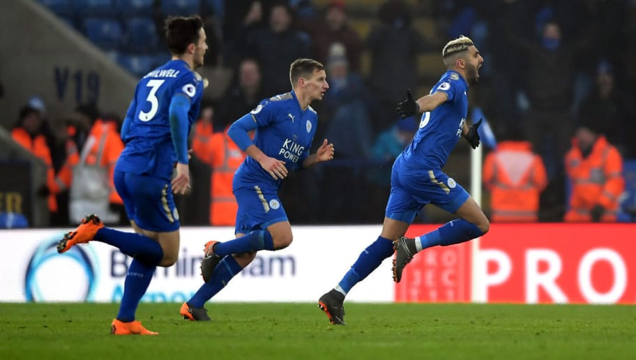 LEICESTER, ENGLAND - MARCH 03:  Riyad Mahrez of Leicester City celebrates scoring his side's first goal with team mates during the Premier League match between Leicester City and AFC Bournemouth at The King Power Stadium on March 3, 2018 in Leicester, England.  (Photo by Laurence Griffiths/Getty Images)