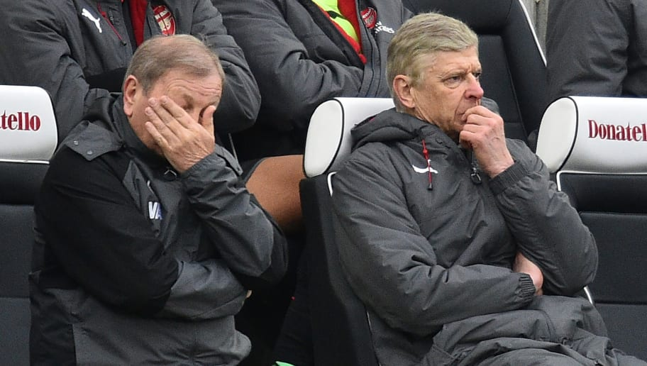 Arsenal's kit manager Vic Akers (L) and Arsenal's French manager Arsene Wenger (R) react in their seats as Arsenal trail, during the English Premier League football match between Brighton and Hove Albion and Arsenal at the American Express Community Stadium in Brighton, southern England on March 4, 2018. Brighton won the game 2-1. / AFP PHOTO / Glyn KIRK / RESTRICTED TO EDITORIAL USE. No use with unauthorized audio, video, data, fixture lists, club/league logos or 'live' services. Online in-match use limited to 75 images, no video emulation. No use in betting, games or single club/league/player publications.  /         (Photo credit should read GLYN KIRK/AFP/Getty Images)