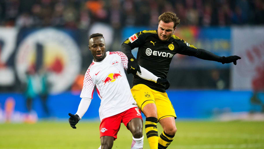 Leipzig's Guinean midfielder Naby Keita (L) and Dortmund's German midfielder Mario Goetze vie for the ball during the German first division Bundesliga football match RB Leipzig vs Borussia Dortmund in Leipzig, eastern Germany, on March 3, 2018. / AFP PHOTO / ROBERT MICHAEL / RESTRICTIONS: DURING MATCH TIME: DFL RULES TO LIMIT THE ONLINE USAGE TO 15 PICTURES PER MATCH AND FORBID IMAGE SEQUENCES TO SIMULATE VIDEO. == RESTRICTED TO EDITORIAL USE == FOR FURTHER QUERIES PLEASE CONTACT DFL DIRECTLY AT + 49 69 650050         (Photo credit should read ROBERT MICHAEL/AFP/Getty Images)