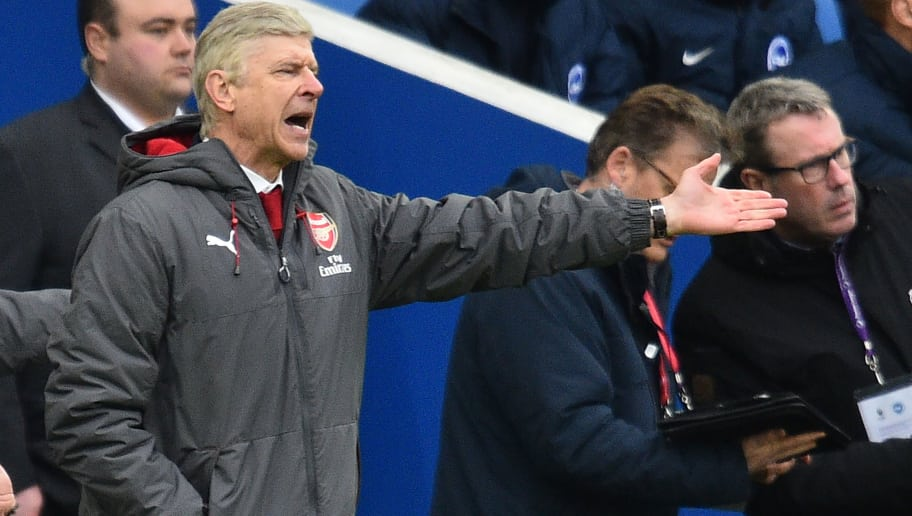 Arsenal's French manager Arsene Wenger gestures on the touchline during the English Premier League football match between Brighton and Hove Albion and Arsenal at the American Express Community Stadium in Brighton, southern England on March 4, 2018. / AFP PHOTO / Glyn KIRK / RESTRICTED TO EDITORIAL USE. No use with unauthorized audio, video, data, fixture lists, club/league logos or 'live' services. Online in-match use limited to 75 images, no video emulation. No use in betting, games or single club/league/player publications.  /         (Photo credit should read GLYN KIRK/AFP/Getty Images)