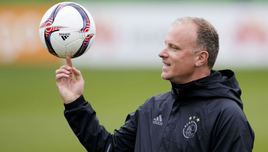 Ajax's Dennis Bergkamp takes part in a training session before the UEFA Europa League match against Schalke 04, in Amsterdam, on April 12, 2017. / AFP PHOTO / ANP / Olaf KRAAK / Netherlands OUT        (Photo credit should read OLAF KRAAK/AFP/Getty Images)
