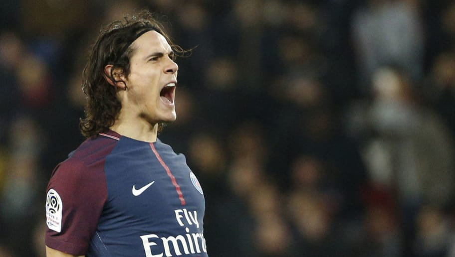 Paris Saint-Germain's Uruguayan forward Edinson Cavani celebrates after scoring during the French Ligue 1 football match between Paris Saint-Germain (PSG) and Strasbourg at The Parc des Princes in Paris on February 17, 2018.  / AFP PHOTO / GEOFFROY VAN DER HASSELT        (Photo credit should read GEOFFROY VAN DER HASSELT/AFP/Getty Images)