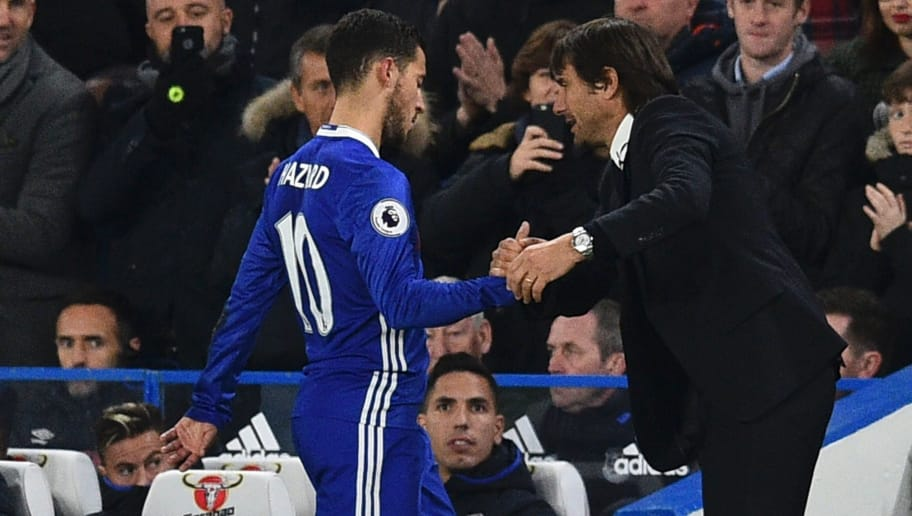 Chelsea's Belgian midfielder Eden Hazard shakes the hand of Chelsea's Italian head coach Antonio Conte (R) after being substituted during the English Premier League football match between Chelsea and Everton at Stamford Bridge in London on November 5, 2016. Chelsea won the game 5-0. / AFP / Glyn KIRK / RESTRICTED TO EDITORIAL USE. No use with unauthorized audio, video, data, fixture lists, club/league logos or 'live' services. Online in-match use limited to 75 images, no video emulation. No use in betting, games or single club/league/player publications.  /         (Photo credit should read GLYN KIRK/AFP/Getty Images)