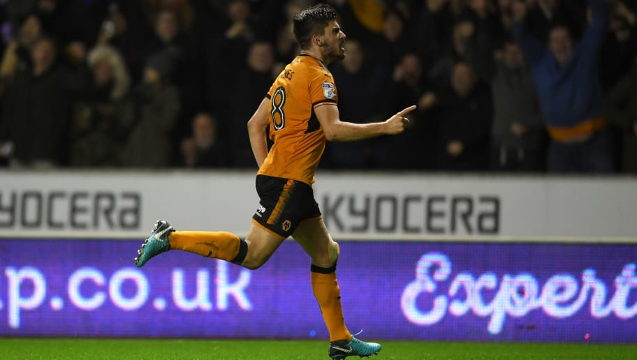 WOLVERHAMPTON, ENGLAND - JANUARY 02:  Ruben Neves of Wolverhampton Wanderers celebrates scoring the opening goal during the Sky Bet Championship match between Wolverhampton and Brentford at Molineux on January 2, 2018 in Wolverhampton, England.  (Photo by Gareth Copley/Getty Images)