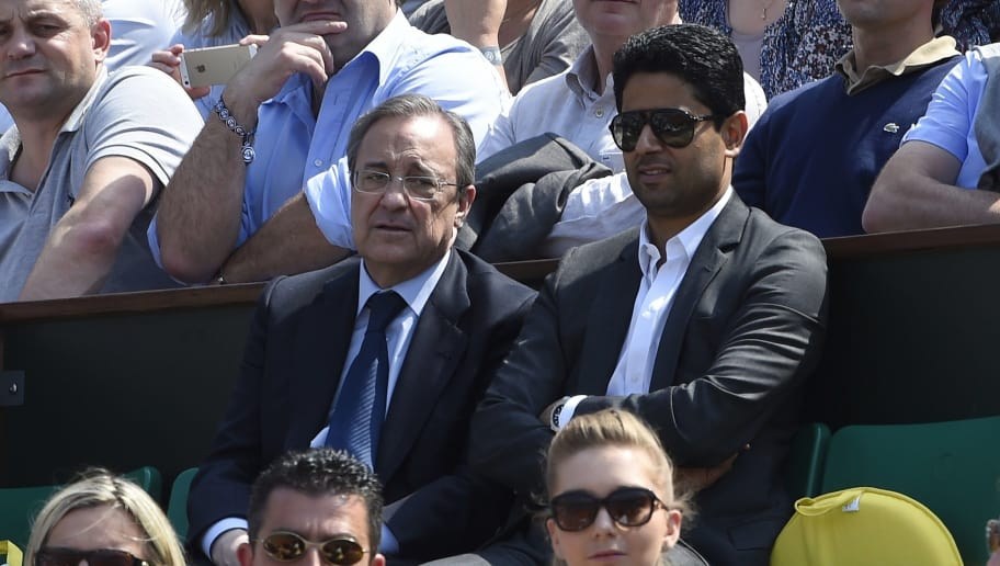 Real Madrid football club president Florentino Perez (C,L) and Paris Saint-Germain chairman Nasser Al-Khelaïfi (R) attend a French tennis Open third round match at the Roland Garros stadium in Paris on May 31, 2014. AFP PHOTO / DOMINIQUE FAGET        (Photo credit should read DOMINIQUE FAGET/AFP/Getty Images)