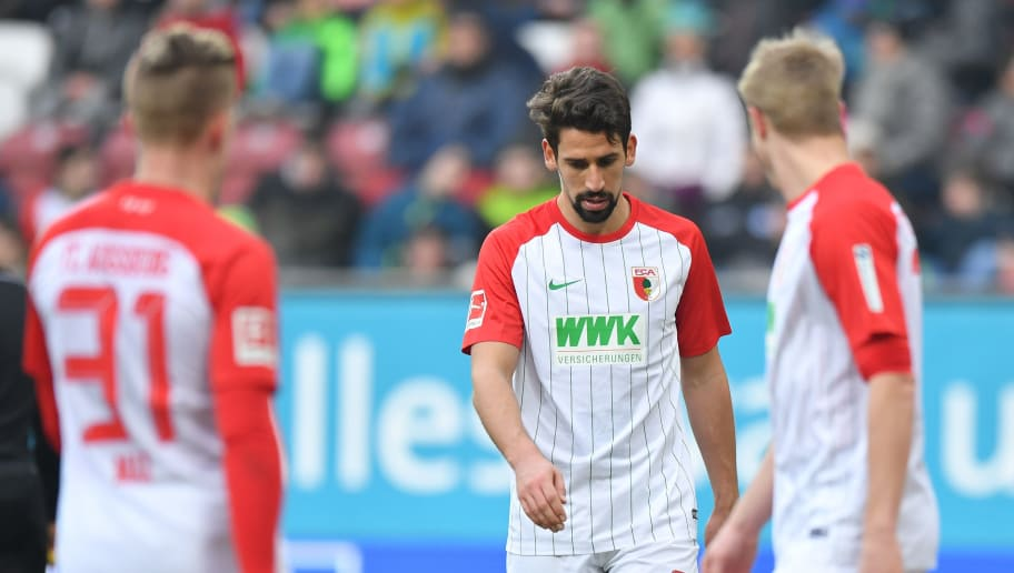 AUGSBURG, GERMANY - MARCH 03: Rani Khedira of Augsburg looks down during the Bundesliga match between FC Augsburg and TSG 1899 Hoffenheim at WWK-Arena on March 3, 2018 in Augsburg, Germany. (Photo by Sebastian Widmann/Bongarts/Getty Images)