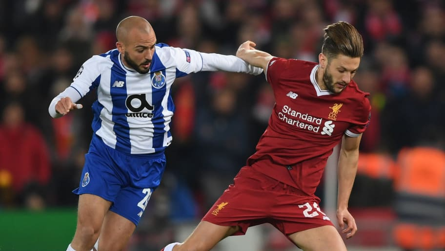 LIVERPOOL, ENGLAND - MARCH 06:  Adam Lallana of Liverpool is fouled by Andre Andre of FC Porto during the UEFA Champions League Round of 16 Second Leg match between Liverpool and FC Porto at Anfield on March 6, 2018 in Liverpool, United Kingdom.  (Photo by Shaun Botterill/Getty Images)
