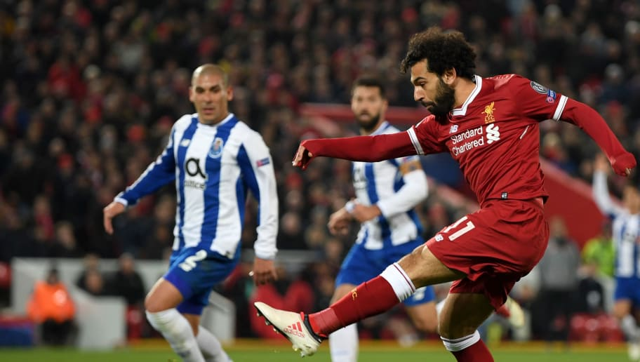 LIVERPOOL, ENGLAND - MARCH 06:  Mohamed Salah of Liverpool shoots during the UEFA Champions League Round of 16 Second Leg match between Liverpool and FC Porto at Anfield on March 6, 2018 in Liverpool, United Kingdom.  (Photo by Shaun Botterill/Getty Images)