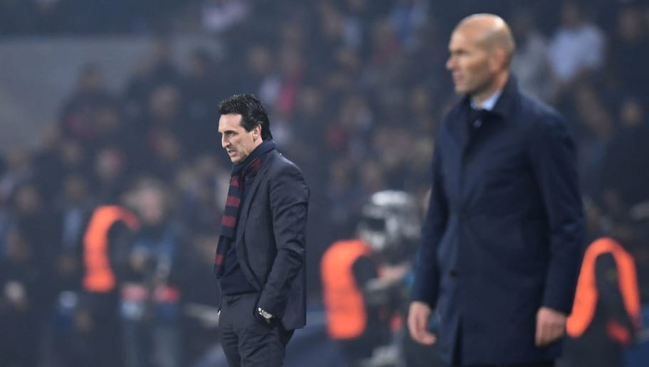 Paris Saint-Germain's Spanish headcoach Unai Emery (L) reacts next to Real Madrid's French coach Zinedine Zidane during the UEFA Champions League round of 16 second leg football match between Paris Saint-Germain (PSG) and Real Madrid on March 6, 2018, at the Parc des Princes stadium in Paris. / AFP PHOTO / FRANCK FIFE        (Photo credit should read FRANCK FIFE/AFP/Getty Images)