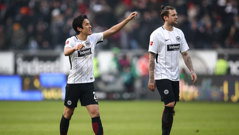 FRANKFURT AM MAIN, GERMANY - MARCH 03: Marco Russ #23 of Eintracht Frankfurt and Makoto Hasebe #20 of Eintracht Frankfurt (L) reacts after the Bundesliga match between Eintracht Frankfurt and Hannover 96 at Commerzbank-Arena on March 3, 2018 in Frankfurt am Main, Germany. (Photo by Maja Hitij/Bongarts/Getty Images)