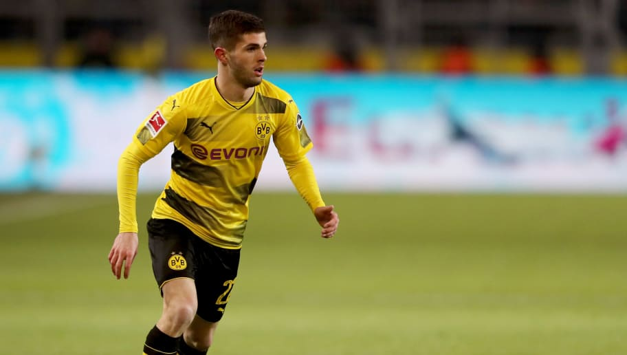DORTMUND, GERMANY - FEBRUARY 26: Christian Pulisic of Dortmund runs with the ball during the Bundesliga match between Borussia Dortmund and FC Augsburg at Signal Iduna Park on February 26, 2018 in Dortmund, Germany. (Photo by Christof Koepsel/Bongarts/Getty Images)