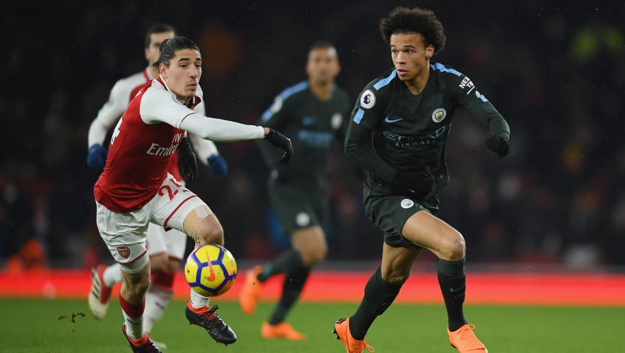 LONDON, ENGLAND - MARCH 01:  Leroy Sane of Manchester City is challenged by Hector Bellerin during the Premier League match between Arsenal and Manchester City at Emirates Stadium on March 1, 2018 in London, England.  (Photo by Mike Hewitt/Getty Images)